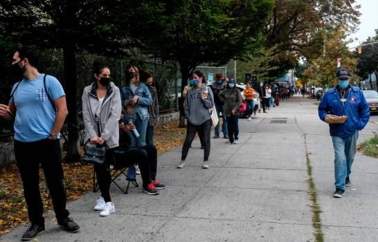 Los neoyorquinos se apresuran a votar para asegurar una amplia victoria de Biden